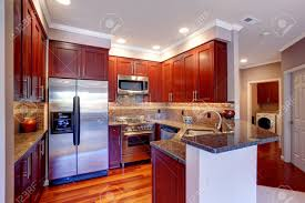 Kitchen With Red Appliances Burgundy Kitchen With Tile Back Splash Trim Steel Appliances
