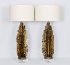 a pair of monumental mid century modern brutalist abstract sculptural table lamps in the manner