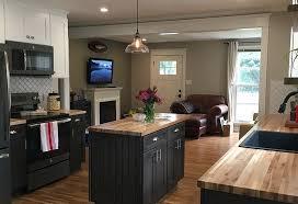kitchen light gray cabinets in kitchen and dark island white decorative pattern backsplash wooden counter