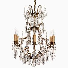 baroque six arm brass chandelier with immitation candles the kairos collective uk