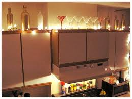 above cabinet lighting ideas. lighting and ivy above kitchen cabinets cabinet ideas