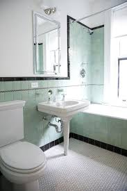 accentuating black border tiles on the bathroom walls