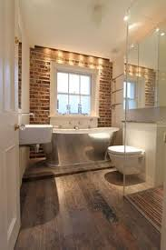 wood floor tiles bathroom. An Exposed Brick Wall, A Metal Bathtub And Vintage Wood Effect Floor Tiles Are What Make This Small Bathroom Design So Special.
