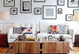 Frame personal photographs for thrifty decor. Image Via: 10 Most Important  Tips Decorating Tight