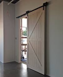 barn door for hallway entry to lounge and kitchen dining from