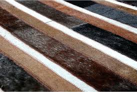 brown striped rug hair on hide detail of black brown and white patchwork cowhide rug in
