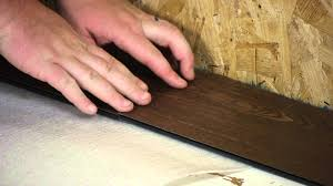 how to install moisture resistant laminate floors in a basement working on flooring