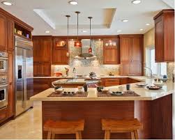 Traditional u-shaped kitchen idea in San Diego with an undermount sink,  shaker cabinets