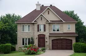 brick home with red garage door