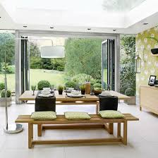 dining room flooring options uk. botanical dining room with bi-folding doors and neutral stone floor flooring options uk