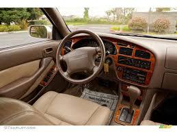 1995 Toyota Camry XLE V6 Sedan Beige Dashboard Photo #82634192 ...
