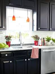 kitchen with black cabinets black cabinets with colored lighting black kitchen cabinets with butcher block countertops