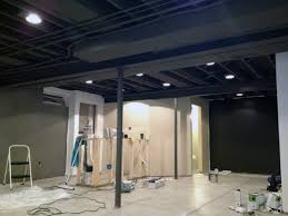 Exposed ceiling lighting basement industrial black Joists Black Painted Exposed Basement Ceiling Ideas Next Luxury Top 60 Best Basement Ceiling Ideas Downstairs Finishing Designs