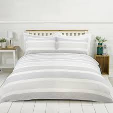 alternatively keep things feeling fresh by mixing crisp white based bedding with rustic wood tones for a bit of charm and character to add that farmhouse