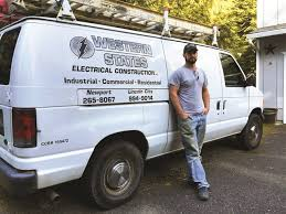 electrician eric sherman s ford e 250 cargo van contains shelves and bins for better organization