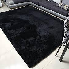 black rug black furry rug