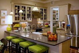 Breakfast Bar In The Kitchen Decorated With Table Lamp And Fruit Basket