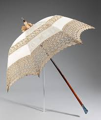 This parasol is beautiful and of the highest quality, as great attention  was paid to every detail. The vulnerable glass handle seems impractical but  ...