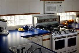 gl block kitchen windows underneath cabinetry