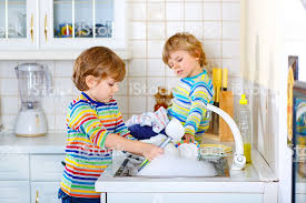 boys washing dishes. Unique Boys Two Little Kid Boys Washing Dishes In Domestic Kitchen Royaltyfree Stock  Photo And Boys Washing Dishes D