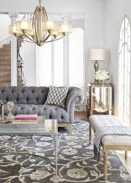 The Chic Technique: Gray-toned furniture and floor coverings keep the color  palette calm, while a graceful chandelier brings in a bit of classic gold.