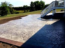 backyard stamped concrete patio with border