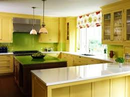 ... Contemporary kitchen cabinets in yellow color with green walls and green  island countertop ...