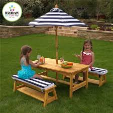 affordable kids outdoor picnic table with umbrella and benches on
