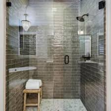 Green Tile Shower With Sleek Glass Enclosure