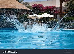 pool water splash. Water Splash In The Swimming Pool