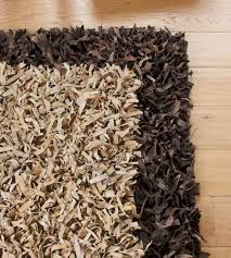 beige leather rug with brown frame