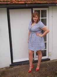 The stylish dress had a square neckline and puffed out at the sleeves. The Kelly Brook Zip Front Jacquard Dress From Simply Be Charli Russon