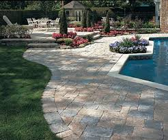 Here's a paver patio design using two contrasting colors and four different  sizes.