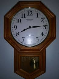 wall clock with pendulum and