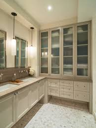 frosted glass cabinet doors. example of a transitional brown tile mosaic floor bathroom design in new york with an frosted glass cabinet doors