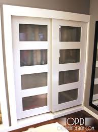 accessories inspirations four glass panel sliding closet door with white frame as space saving