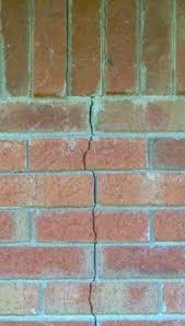 exterior brick mortar repair. a crack in masonry wall. exterior brick mortar repair n