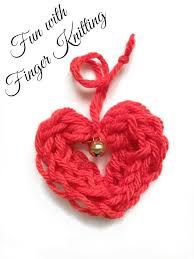 next up we have some fun wool or yarn valentine s day decorations i bit of knitting pom poms and weaving
