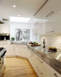 white cabinets with stainless steel countertops. Modern Kitchen With Stainless Steel Countertops Also Corner Sink And White Sleek Cabinets Using