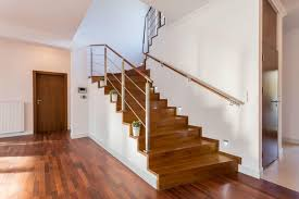 wooden floors and stairs with steel posts