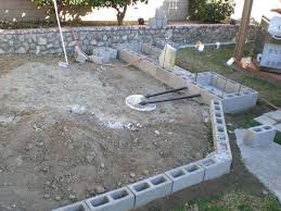 picture of lay first course of cinder blocks