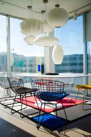 George Nelson bubble lamps, Eero Saarinen tulip table, Harry Bertoia chairs  and Mondrian rug