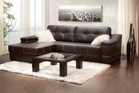 dark espresso leather apartment size sectional sofa with white fur cushion and square coffee table on white fur rug elegant idea