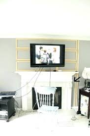 tv above fireplace wires above fireplace how to hide wires above fireplace pics over