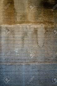rusty door texture of an old garage door and wall stock photo 34327774