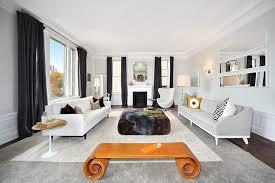 contemporary living room curtains. dark drapes anchor the light, breezy living room [design: interior marketing group] contemporary curtains l