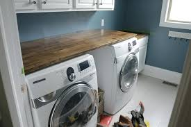 countertop washer washing machine with spin cycle hinged over and dryer dishwasher