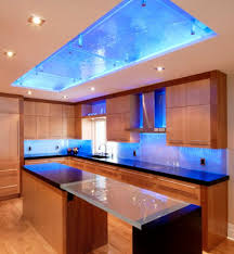 Very cool colored cove lighting above the kitchen island ...