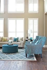 Furniture With Crypton Fabric Sofa Living Room Transitional Area Rug  Beige Walls Blinds Blue Pillows Printed Sofas73