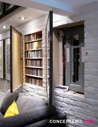 how designers create hidden storage media storage, basements and hide fuse box hidden fuse box and media storage in wall hidden by hinged art frames for basement remodel